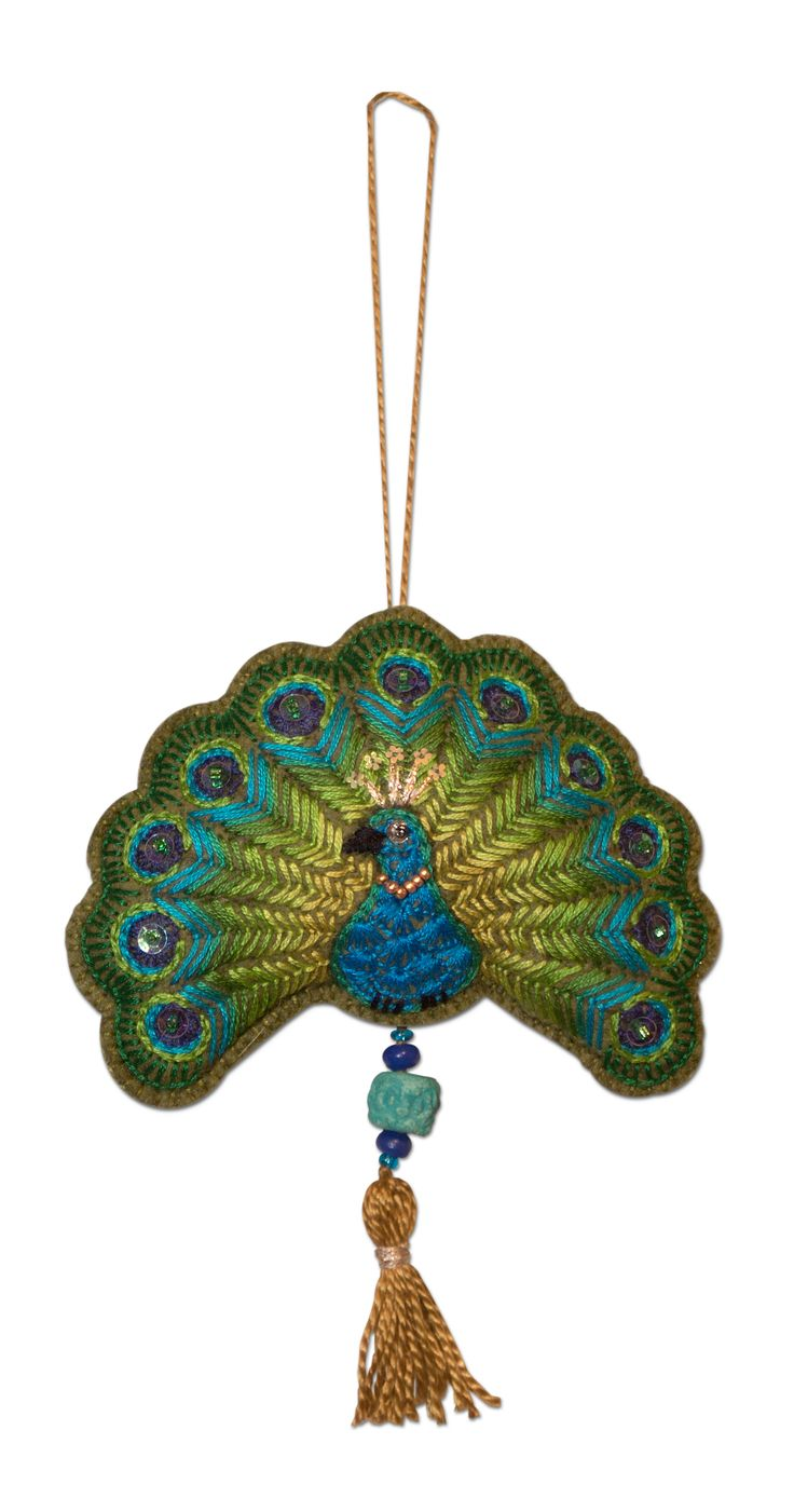 Embroidered Peacock Christmas Ornament. Hand stitched on wool felt; stitches include Buttonhole Stitching and Scallops, Chain and Fly Stitch (one of my favorites for making the peacock feathers)