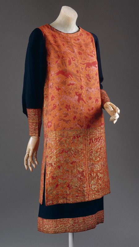 Day dress, ca. 1924 | Callot Soeurs. Woven cashmere embroidered with gold thread | Referencing Persia, the Callot Soeurs here created a kind of artistic dress of the 1920's, stark in tubular silhouette but with ornamented surface. The day dress with collarless tunic employs a vestigially Ottoman, angled sleeve with narrow cuffs | The Metropolitan Museum of Art, New York