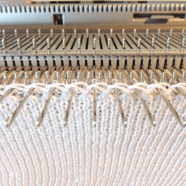 Re-hanging for an eyelet seam #machineknit #knitwear #knitting #textiles #lillianjacksontextiles #slowfashion #sustainablefashion #cashmere #cotton