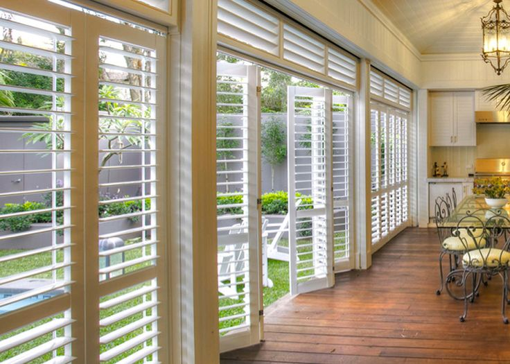 Outdoor Living Areas with Aluminum Areas = Bi-folding shutter walls.