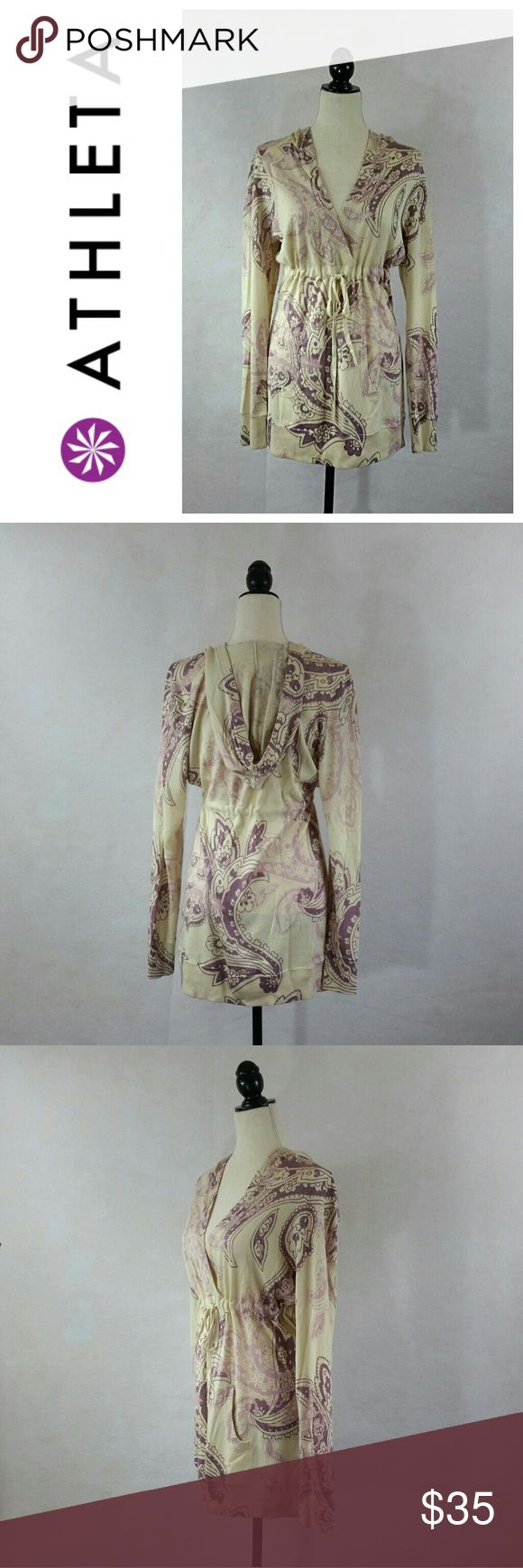 """Athleta hoodie dress Sz L So adorable hoodie long sleeve dress in great used condition with very minimal signs of wear. Dress has two front pockets and adjustable belt.  Size  L Color  Cream & Old Rose  Materials: 52% Silk 35% Polyester 13% Cotton  Approximate measurements: Chest - pit to pit  :   20"""" Length from shoulder to bottom hem  :  30""""   Please see photos for more details. Feel free to ask questions. Athleta Dresses Long Sleeve"""