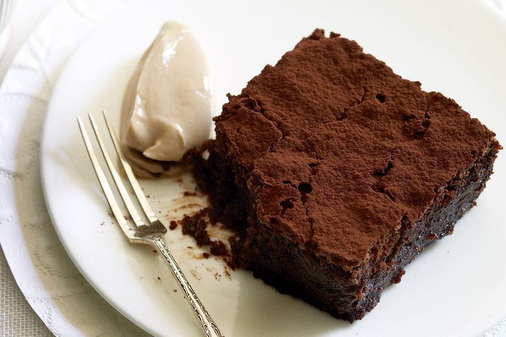 Indulge a little with a slice of this heavenly flourless chocolate cake.