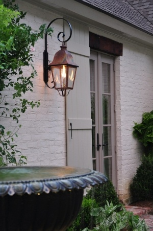 exterior french doors with shutter & lantern and painted brick with timber inset over doors/windows