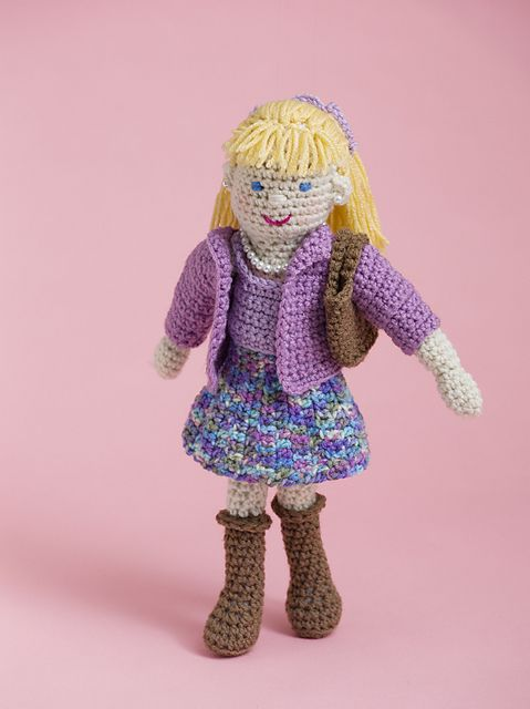 A classic girl, Lucy prefers conservative outfits and loves home décor. She's a natural giver who spearheads charity stitching groups. Crochet her from head to toe including undergarments and shoes and then dress her in a top, cardie sweater and skirt. She likes to complete her outfit by accessorizing with pearl necklace and earrings.