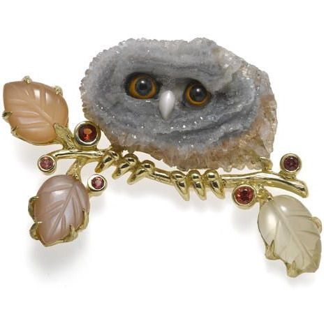 A drusy quartz, agate, mother-of-pearl, carved moonstone and orange sapphire owl brooch, Sandrajean Wainwright.