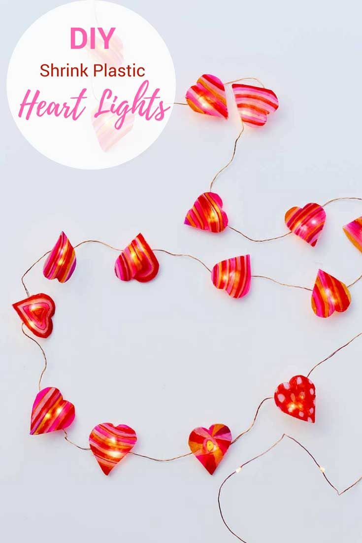 Brighten up your home for Valentine's day with these DIY heart string lights. Made with shrink plastic and sharpies. #sharpiescraft #valentinescraft #valentinesday #valentinesdecor #stringlights.