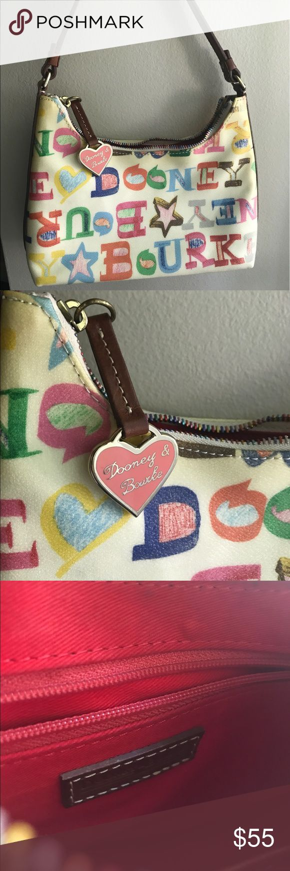 DOONEY&BOURKE White Doodle Mini Shoulder Bag Authentic designer handbag that is like NEW! Genuine White to cream colored leather with colorful Dooney&Bourke lettering. The inside is a beautiful red color and includes a zip pouch and a pocket pouch. This classic handbag is in excellent condition with no stains, scuffs, or scratches! Dooney & Bourke Bags Shoulder Bags