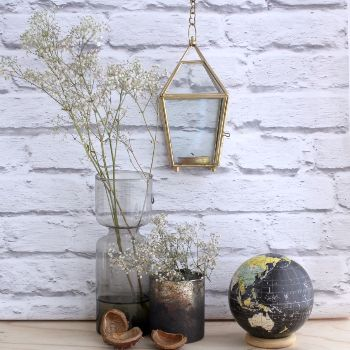 Brass Lantern Tea Light Holder: A gorgeous and decorative tea light holder. This tea light holder sits in a glass shaped lantern. With feet and a metal chain with loop, this tea light holder can either sit on a stable surface or can be hung.