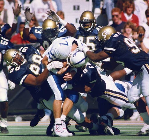 Five Yellow Jackets sack the Duke quarterback, 1990. AJCP203-013c, Atlanta Journal-Constitution Photographic Archives. Special Collections and Archives, Georgia State University Library.