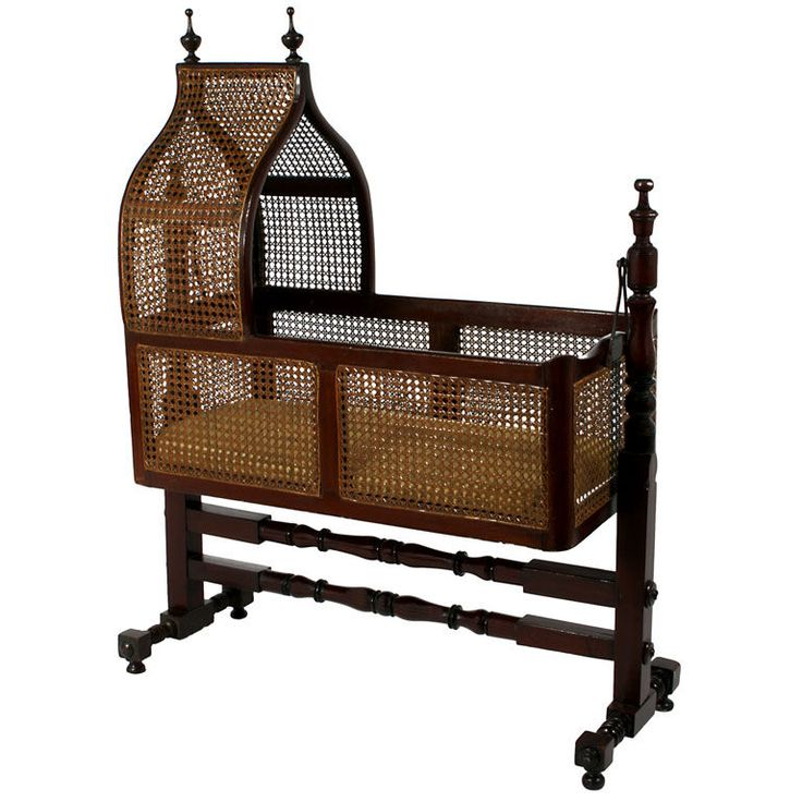 A Victorian Caned Hanging Cradle or Bassinet. England circa 1880 A Victorian cane-filled hanging bassinet with peaked hood.