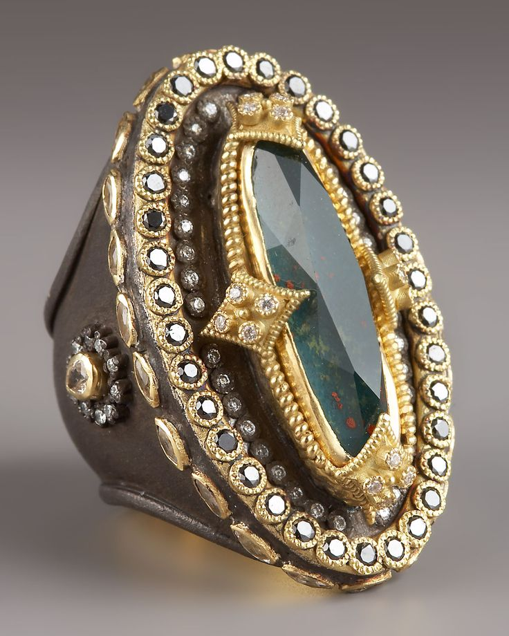 Ring | Emily Armenta.  Oxidized sterling silver with 22-karat yellow gold bezels, blood stone, white and black diamonds and sapphires.