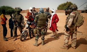 Malian and French soldiers patrol during anti-insurgent operations in Tin Hama, Mali, 19 October.