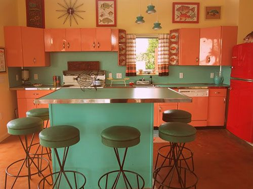 Brand new pool house built retro with coral metal cabinets and turquoise boomerang laminate counters.