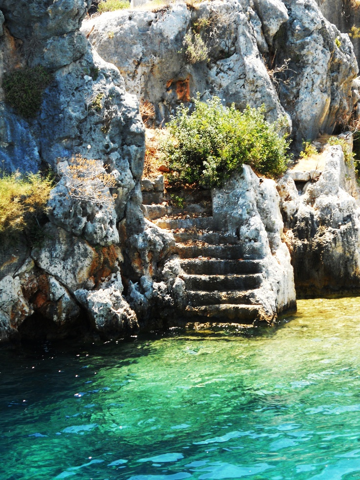 Kekova Island: In the clear sea water you can see the remains of stairs and walls of the Sunken City. It is believed that an earthquake destroyed this ancient city in 2 AD, slipping under it below the water surface, as it was the case of the cities of Aperlai and Simena.