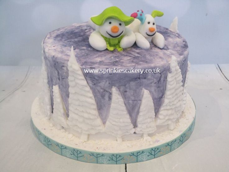 This rich rum soaked fruit cake was first covered in royal icing and then handpainted, then finished with handmade fondant decorations.