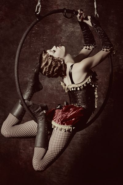 I haven't been able to discover who this is, but I love it so - the costume, the pose, her hair.  I think its time to run away with the circus again. Image found here