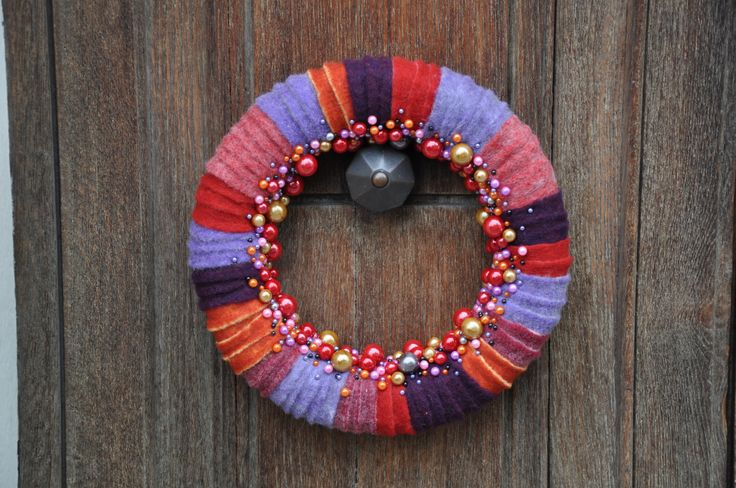 Brightly Coloured Wool Wreath Use Lehner Wolle³ Wool within your floral arrangements and decorations. View the colours and styles available on the website www.oasisfloral.com