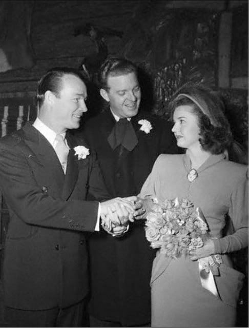 Roy Rogers and Dale Evans on their wedding day in 1948. Wedding suits were more common in the 40's and early 50's.