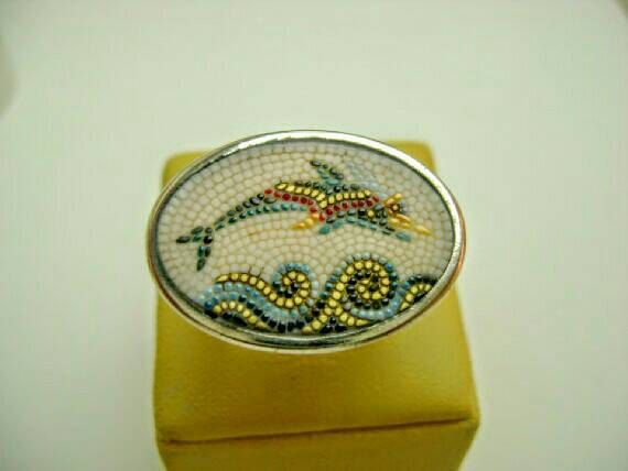 Check out this item in my Etsy shop https://www.etsy.com/uk/listing/170016594/mosaic-dolphin-ring-santorini-greece