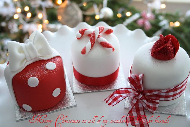 Mini Christmas cake with white icing and gingham ribbon