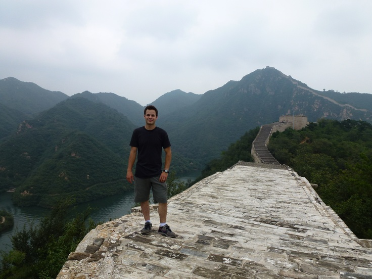 Trevor, one of our all around guides, taking a looking at the Great Wall of China! #Travel #China