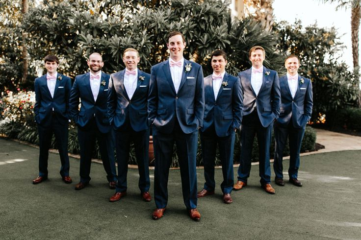 Groom and groomsmen style inspiration: Navy suit and light pink bow tie (Gloria Goode Photography)