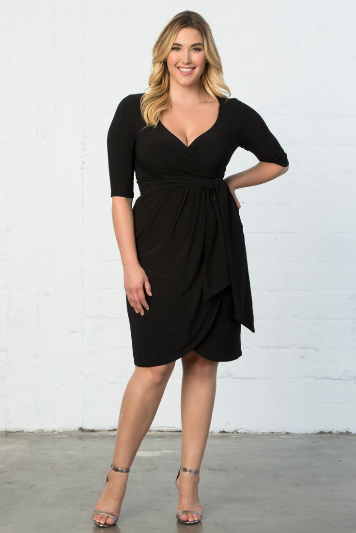 Our plus size Harlow Faux Wrap Dress makes the wrap look easy with a pullover design on this little black dress. Shop our entire collection online at www.kiyonna.com.