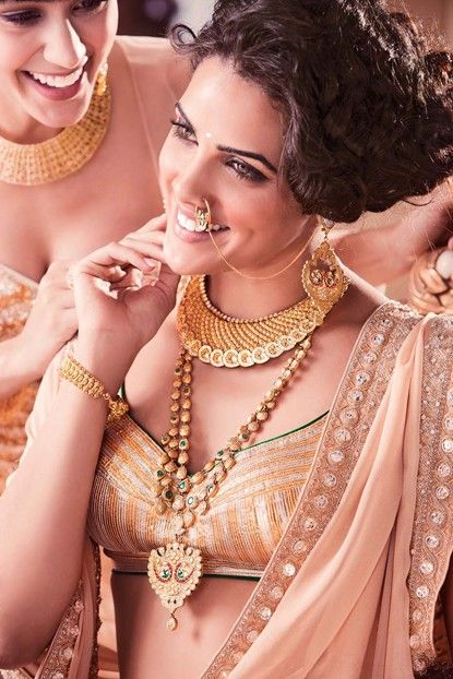 Jewelry collection by TanishQ. Love the statement necklace, long chain and earrings