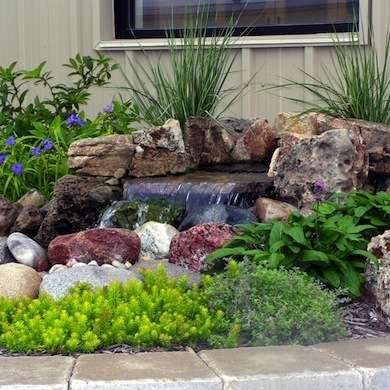 10 water features to make any backyard landscape complete for Build your own waterfall pond