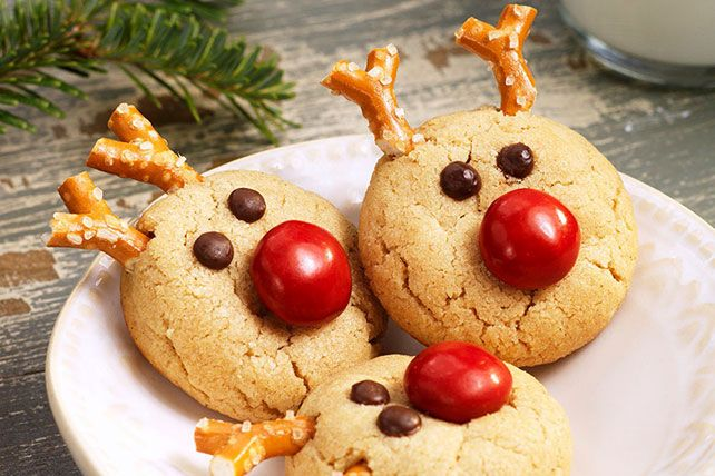 Transform a simple peanut butter cookie recipe into a cute reindeer cookie with the addition of chocolate candies, chocolate chips and pretzels.  Our peanut butter cookie recipe will  become a favourite during the festive season.