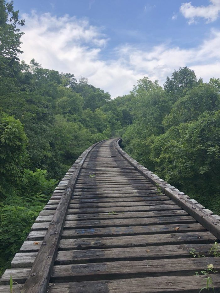 Today, this abandoned railroad trail is a hauntingly beautiful sight