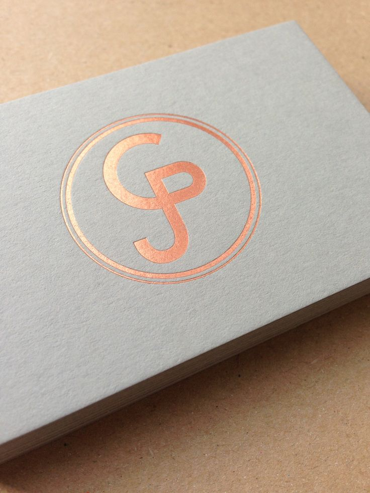 Copper foil logo on pale grey foil business cards