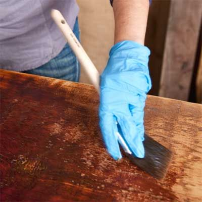 8. Complete the Table Complete the table by applying shellac to darken the wood and seal it. Let dry, and follow with a coat of beeswax polish to fill surface cracks. Now gather your friends for a celebratory potluck to christen your new table. Next