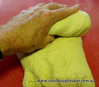 Rolling dough into a cylinder, good kneading article.