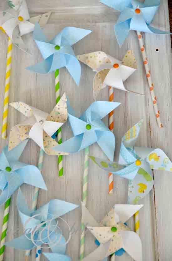diy paper pinwheels stuck on the end of paper straws (but in yellow and white), stick them in minivases on display tables.