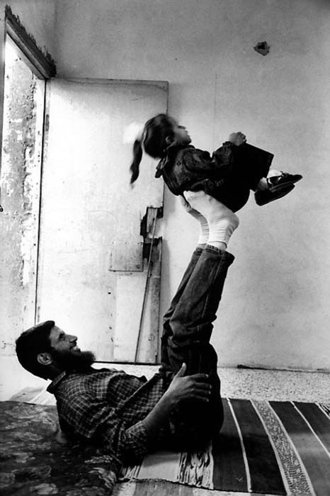 One of 400 Expelled Palestinians with his daughter after His Return Home, Deir El-Balah Camp, Gaza, Palestine, 1995.