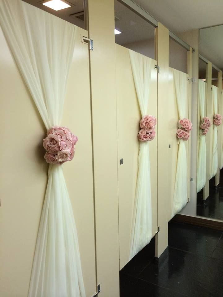 This is lovely ... simple decorations for the bathroom stall doors!