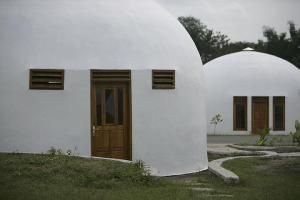 Monolithic dome homes in the village of New Ngelepen on Java Island, Indonesia - Photo © Dimas Ardian/Getty Images