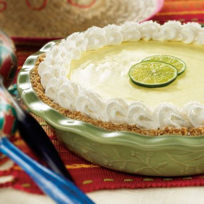 Margarita Pie | Meals.com - Start with a margarita in hand - and end with one on your fork! This party-perfect Margarita Pie is made with fresh limes and oranges (tequila optional - but you'll love the extra kick!). All in a salty pretzel crust.  #MargaritaPie #MexicanNight