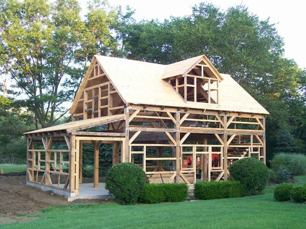 Wood barn kit pictures timber frame kit homes gallery for A frame building kits