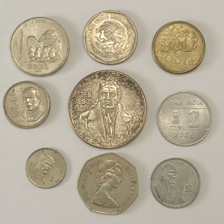 9 international coins 7 mexico 1 british 50 new pence
