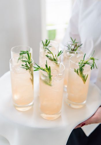 Specialty gin cocktail with rosemary sprig from the PPHG team | Lowndes Grove Plantation in Charleston, South Carolina | Photo by Dana Cubbage Weddings