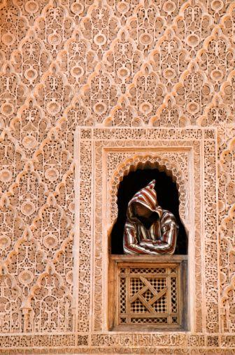 Africa | Muslim man standing in a window, Marrakesh, Morocco | ©Martin Harvey
