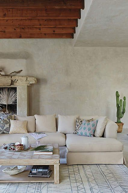 The Linen Novalie Slipcover Sectional is a relaxed, yet sophisticated crowd-pleaser, has extra-deep seats, generous rolled arms and a neat, tailored slipcover.