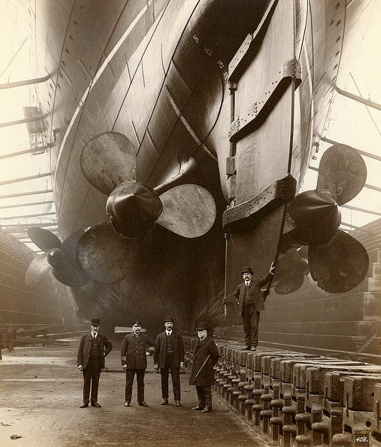 "RMS Mauretania at the Canada Dock in Liverpool, 1909.The gentleman in uniform is ""Mauretania's"" first Chief Engineer, John Currie. via Tyne & Wear Archives & Museums"