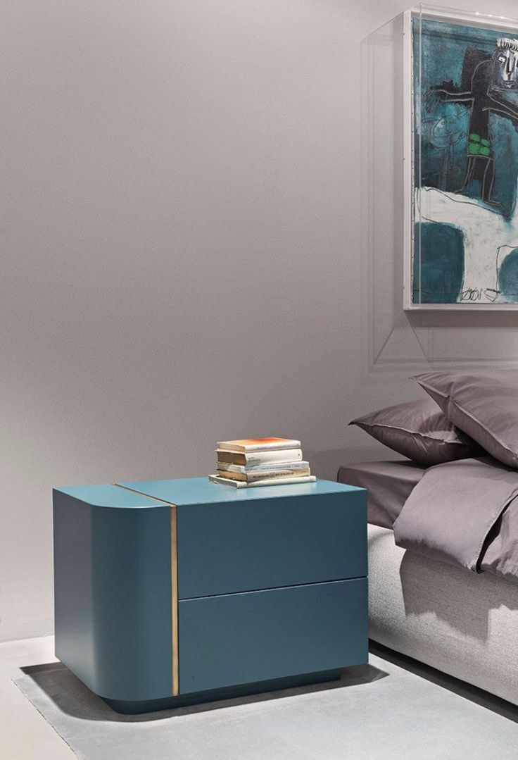 Sharp lines on this modern nightstand with just a stripe of wood showing.