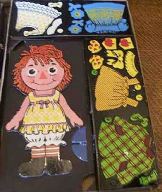 """""""Color forms"""" These came in all kinds peel and place object, but I remebering back it was a girl/friend who had a """"Raggety Ann"""" that I remember first dressing, also they had them at school to teach kids how to dress correctly.. First your socks, then your shoes, no pants?. DOPE!!!..:-)"""