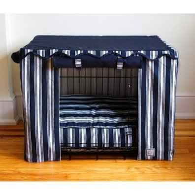 Buy or sew your own crate cover for the pup.