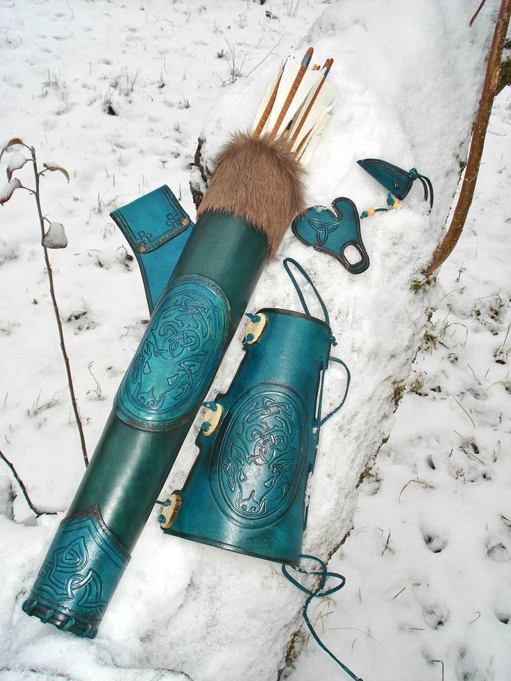 Hip Quiver & Arm Guard in a Tooled Archery Leather Set Blue Celtic Stag. without the fur it would rock.