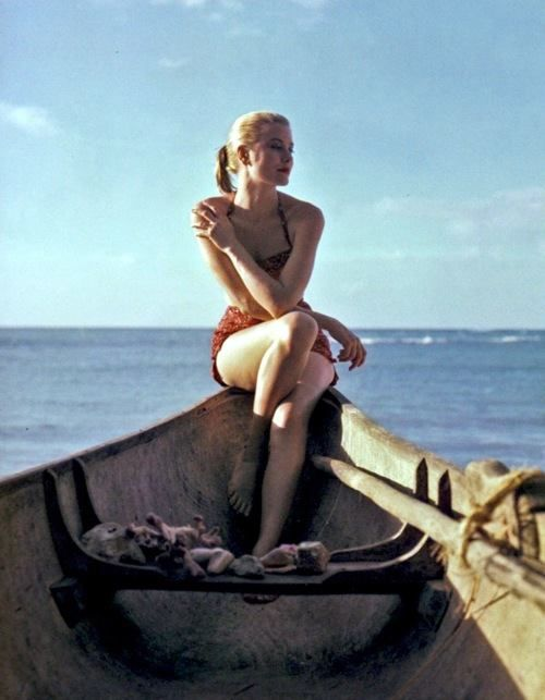 Grace Kelly captured on a boat by photographer Howell Conant in Jamaica, 1955.  Check out  on the blog 10+1 of the most iconic #retrobeachmoments  #mitos #mitoswimwear #celebrity #sun #sea #boat #summer #sand #film #retro #vintage #moroccan #mosaic #life